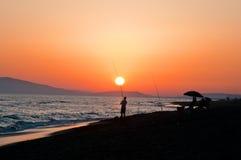 Pesca en la puesta del sol Toscana imagen de archivo libre de regalías