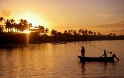 Pesca en la salida del sol Fotografía de archivo libre de regalías