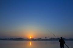 Pesca en la salida del sol Imagen de archivo libre de regalías
