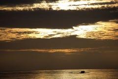 Pesca en la salida del sol Imagenes de archivo