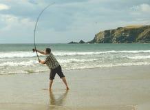 Pesca en mar en la playa Imágenes de archivo libres de regalías