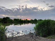 Pesca en puesta del sol Foto de archivo