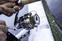 Pesca extrema do inverno Fotografia de Stock