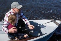 Pesca feliz del hombre con su hijo Fotos de archivo libres de regalías