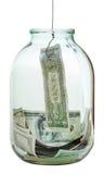Pesca fuori della banconota dei dollari dal barattolo di vetro Fotografia Stock Libera da Diritti
