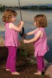 Pesca gêmea das irmãs Foto de Stock Royalty Free