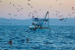 Pesca industriale e pesca fotografia stock