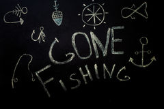 Pesca, inscrição no giz em um fundo preto imagem de stock royalty free