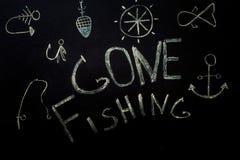 Pesca, iscrizione in gesso su un fondo nero immagine stock libera da diritti