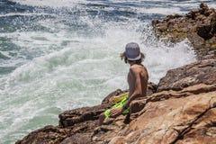 Pesca joven del adolescente por el mar Imagen de archivo libre de regalías
