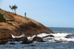 Pesca na costa Imagens de Stock
