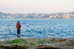 Pesca na praia Foto de Stock