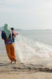 Pesca no estilo chinês da praia Foto de Stock Royalty Free
