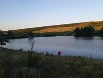 Pesca no lago Fotografia de Stock