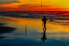 Pesca no por do sol Imagens de Stock