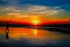 Pesca no por do sol Fotografia de Stock Royalty Free