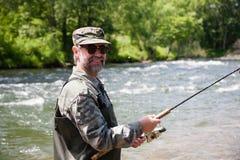 Pescador alegre Imagem de Stock