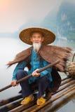 Pescador chino del cormorán imagenes de archivo