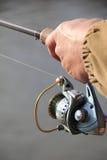 Pescador com giro Imagens de Stock Royalty Free