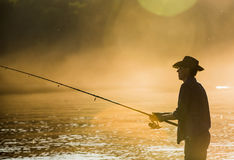 Pescador com giro imagem de stock