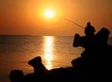 Pescador com o Rod Fotos de Stock Royalty Free