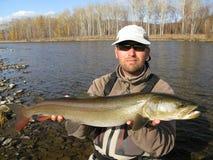 Pescador com peixes Imagens de Stock Royalty Free