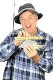 Pescador con la regla imagenes de archivo