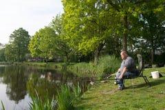Pescador con las cañas de pescar Foto de archivo libre de regalías