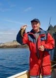 Pescador con los pequeños pescados Fotografía de archivo libre de regalías