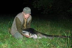 Pescador con los pescados grandes Imágenes de archivo libres de regalías