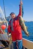 Pescador con los pescados grandes y el giro Imagen de archivo libre de regalías
