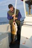 Pescador con los pescados muy grandes Foto de archivo libre de regalías