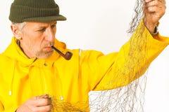 Pescador con su red fotografía de archivo