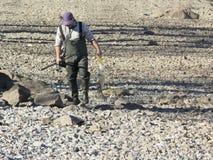 Pescador con su retén Foto de archivo libre de regalías