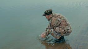Pescador con un retén metrajes