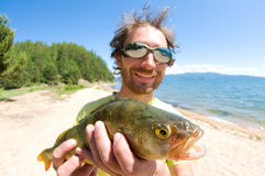Pescador con un retén imágenes de archivo libres de regalías