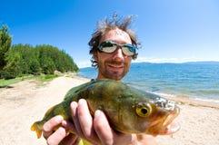 Pescador con un retén fotografía de archivo libre de regalías