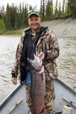 Pescador con un retén grande fotografía de archivo libre de regalías