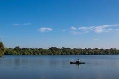Pescador de la canoa Fotos de archivo libres de regalías