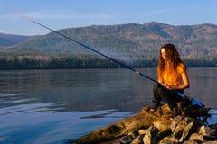 Pescador de la muchacha foto de archivo