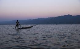 Pescador de la puesta del sol Foto de archivo libre de regalías