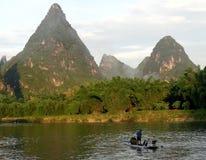 Pescador del cormorán en China Foto de archivo