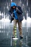 Pescador del hielo Foto de archivo libre de regalías