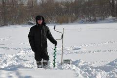 Pescador del invierno Foto de archivo