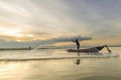 Pescador e nascer do sol Imagem de Stock