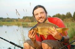 Pescador e peixes imagens de stock
