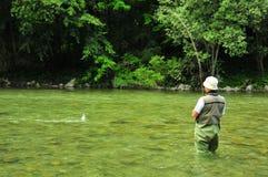 Pescador e truta Fotografia de Stock Royalty Free