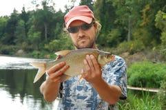 Pescador e um peixe imagens de stock royalty free