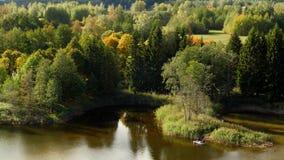 Pescador em um barco de borracha em um lago, paisagem do outono vídeos de arquivo