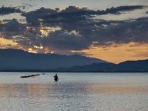 Pescador en amanecer Fotografía de archivo libre de regalías